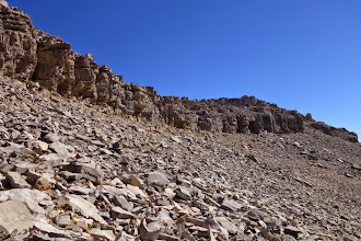 Photo: A rock band guards the summit.  The weakness can be found on the south end.