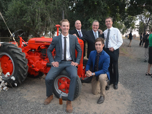 Four generations of Carberrys have farmed Narrabri district property Cadarga, beginning with Stan Carberry in 1918. Above, at Saturday's 100 year celebration, back centre, Stan's son Pat with his son Michael, left, the late Bill Carberry's son Andrew, right,  and Michael's son Sam, front left, and Andrew's son Tom. The 1942 tractor is part of farm history.