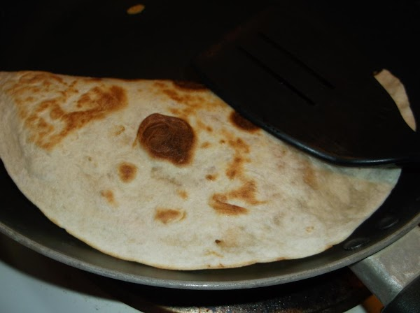 Slide folded fajita onto serving plate; top with lettuce, salsa and sour cream. Serve...