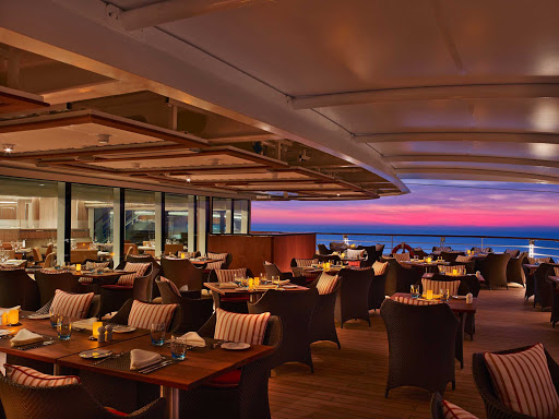 Watch the clouds turn pink at sunset from The Colonnade during your Seabourn Encore sailing.