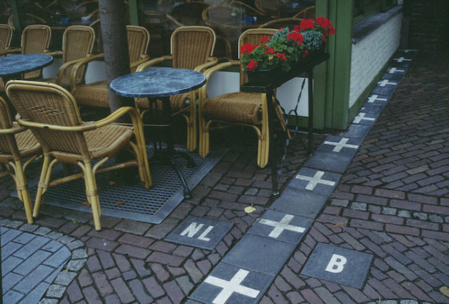 8) Netherlands and Belgium - The borders in the town of Baarle are the most confusing borders in the world. The entire town is surrounded by The Netherlands but 26 separate pieces of the town belong to Belgium. For clarification and the interest of tourists, the border is made visible on all the town