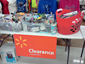 Photo: First thing we come to is several clearance tables full of neat things.