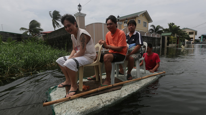 Photo: 20120803 Residents of Dampalit in Malabon City wade thru flooded streets using improvised bancas/floaters as they go on their daily life. Strong rains for the last couple of days brought flooding in many parts of the metro. Photo by RemZamora