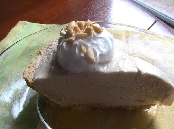 Cut into 8 servings and top with additional whipped topping and chopped peanuts.