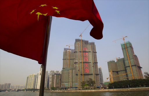 A Chinese national flag flutters on the Pearl River in Guangzhou, Guangdong province, China.  Picture: REUTERS