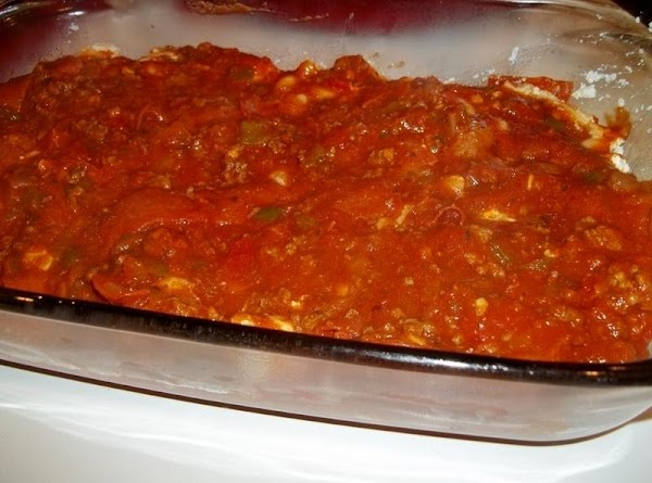 Now, add 2 - 2 1/2 cups meat sauce; spread evenly.