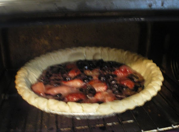 Preheat oven to 350 degrees.  In a medium bowl combine berries and almond...