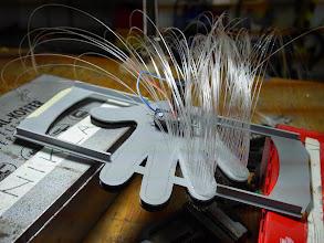 Photo: Gluing 500 strands of optic fibre for the decoration of the sensor