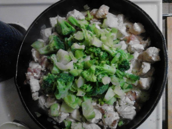 Turn heat to med-low, add broccoli florets. (I just dumped mine on top, no...