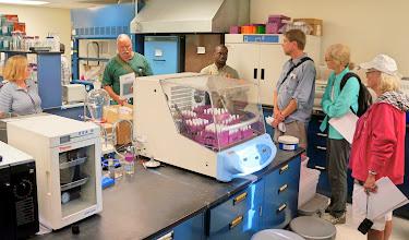 Photo: We first visit the plant pathology laboratory of Tony Adesemoye, Asst. Professor.
