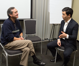 """Photo: Ron Hickling, CA E '80, listens toan """"Elevator Pitch"""" from Michael Fu, MA B '15, during a professional development session on Thursday afternoon."""