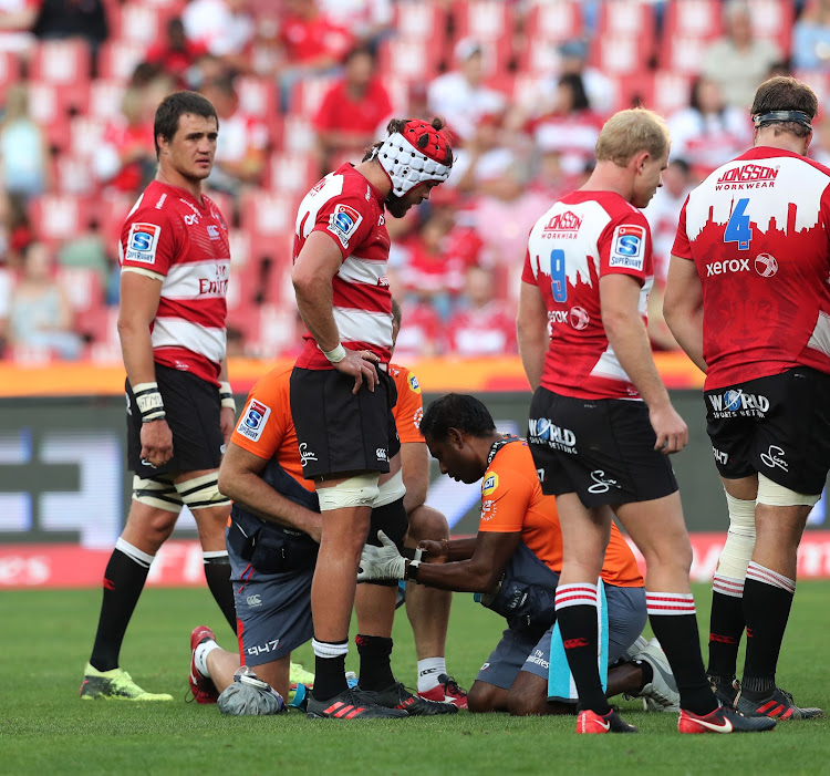 The Emirates Lions captain Warren Whiteley gets medical attention on the field after sustaining an injury to his knee during the Super Rugby match against the Blues at Ellis Park, Johannesburg on 10 March 2018.