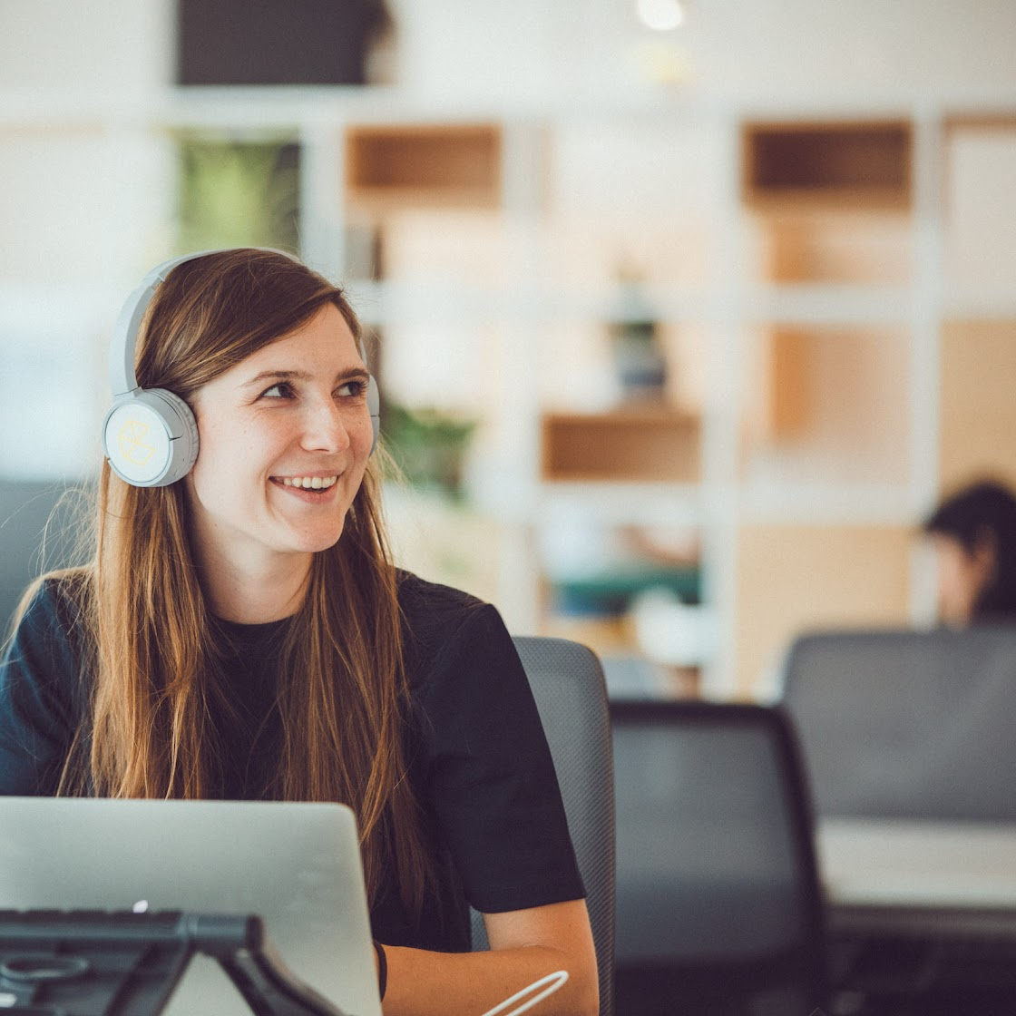 Woman with headphones on, Startup School: Restart, Campus Madrid, Google for Startups