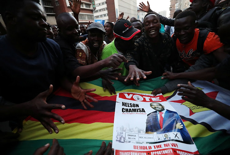 Supporters of the opposition Movement for Democratic Change party of Nelson Chamisa sing and dance in the street outside the party's headquarters following general elections in Harare, Zimbabwe, July 31 2018. Picture: REUTERS