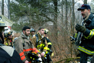 Photo: Norm Cummings SPECTRUM/Patterson, N.Y. firefighter Matt Szpindor coaches firefighters before Jan. 13, 2007 drill at Mill Pond in Sherman
