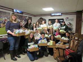 Photo: Students from St Mary's Church helping to make the May Baskets.