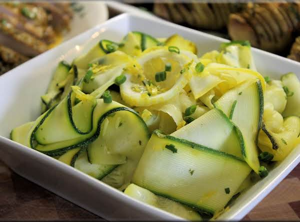 Thin Sliced Zucchini And Yellow Squash Ribbons With Fresh Herbs And Lemon