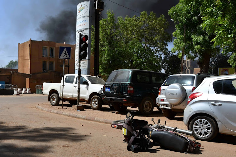 Smoke rises from the site of an attack in downtown Ouagadougou, Burkina Faso March 2 2018. Picture: REUTERS/ANNE MIMAULT