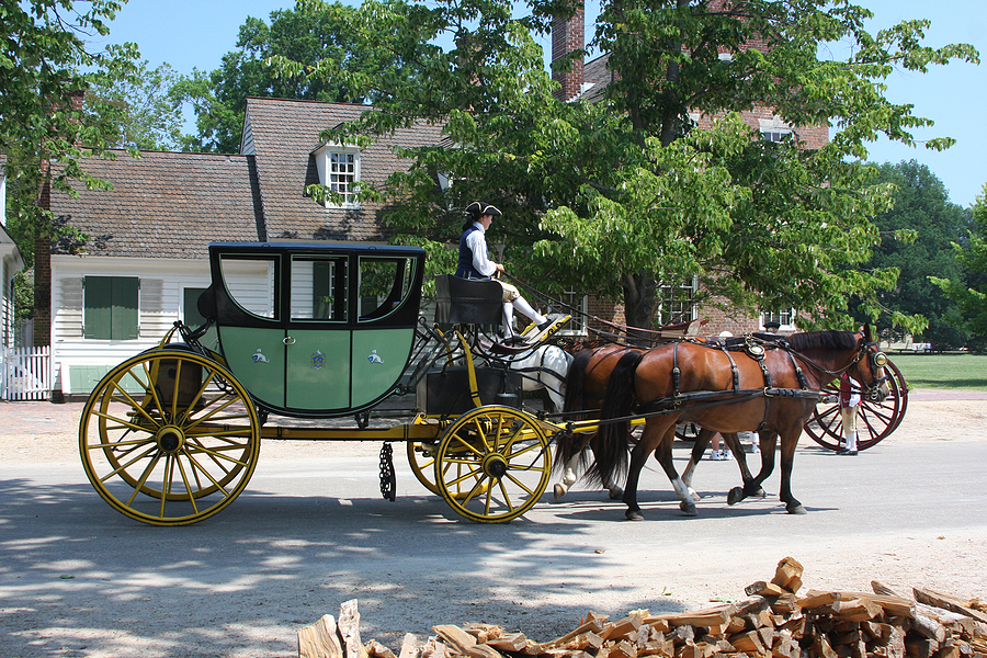 Traditional horse and buggy in front of historic Williamsburg, VA house