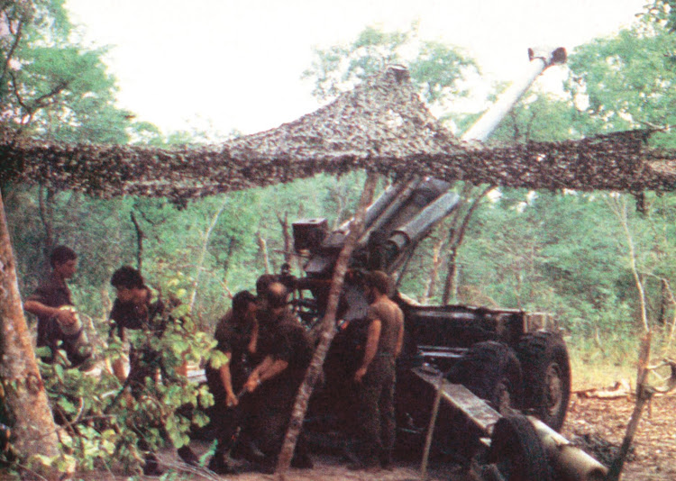 South African 155-mm G-5 artillery on the outskirts of Cuito Cuanavale pounding Cuban and Angolan positions. The guns were carefully camouflaged against enemy air attacks.