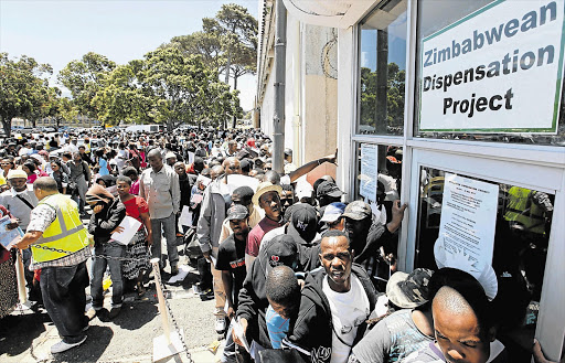 Zimbabweans stand in a long queue at a Home Affairs office in SA when a deportation deadline loomed. File photo.