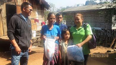 Photo: Doi Ngam - Homecare visit bringing provisions and clothing