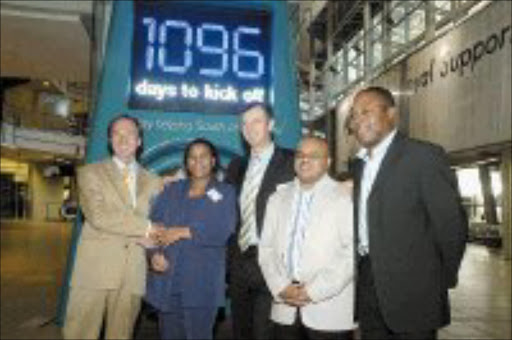 SAY CHEESE: FNB's Derek Carstens, left, and Michael Jordaan, centre, with City of Joburg's Sibongile Mazibuko, Fifa 2010 marketing executive Sandile Ndzekeli and 2010 ambassador Kalusha Bwalya. Pic. Mabuti Kali. 10/06/2007. © Sowetan.
