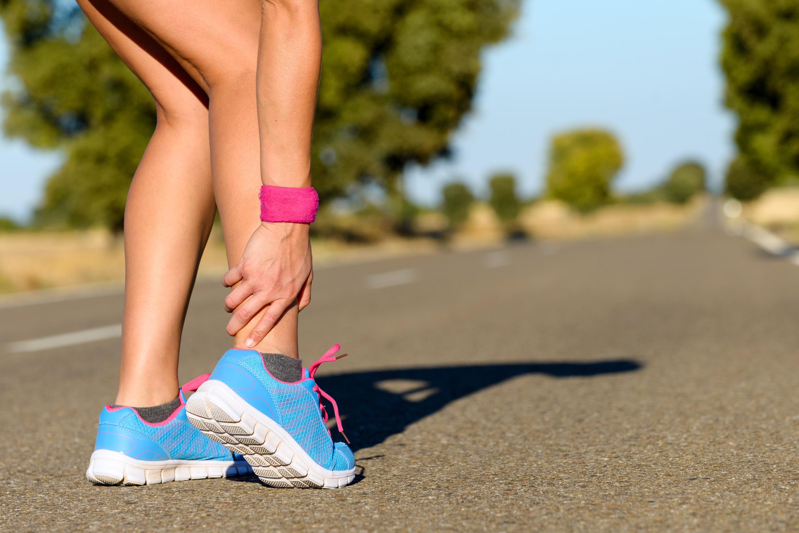 Female runner with leg pain