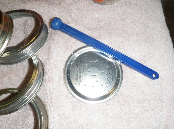 Remove a lid (use a magnet lifter) from the hot water and wipe off...