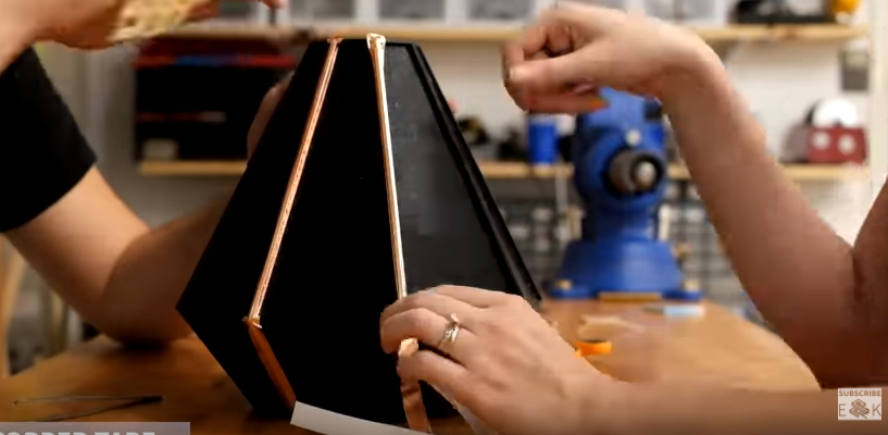 Applying the copper tape to the 3D printed part