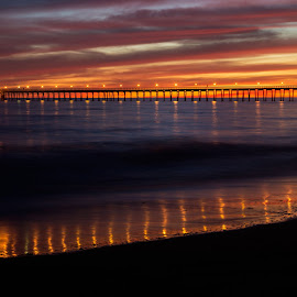 Pier at Sunset by Chris Seaton - Landscapes Beaches ( water, lights, colorful, sunset, reflections, pier, ocean, beach, evening,  )