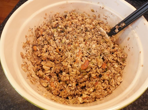 Pour the sugar mixture over the oats and nuts. Mix well.