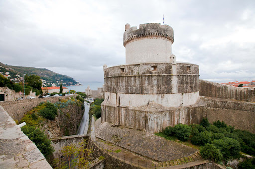 Dubrovnik-battlement.jpg -  A medieval tower and battlements that once stood guard over Dubrovnik, City of Stone and Light. The walls rise 25 meters high (82 feet) in some places.
