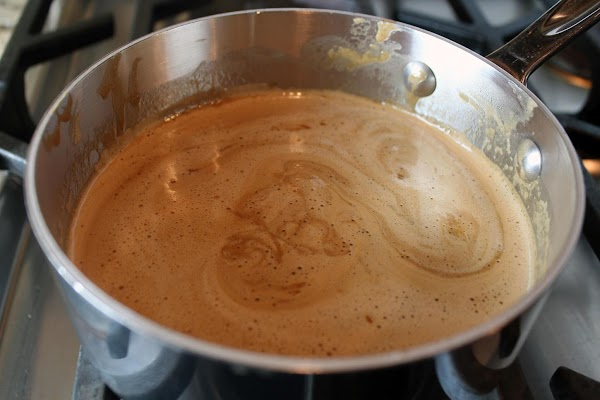 In small saucepan, over low heat, add frosting and rum stirring until combined. Remove...