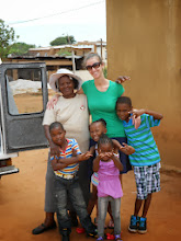 Photo: The family she lived with during her Peace Corps service in South Africa were eager to see Hilsinger during a visit in December of 2012.