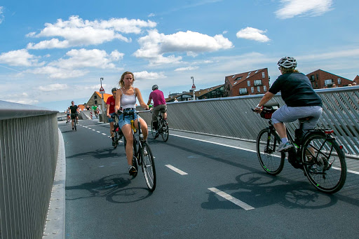 copenhagen-bicyclists.jpg - Bicyclists cross a canal footbridge that connects Nyhavn with Christianshavn.