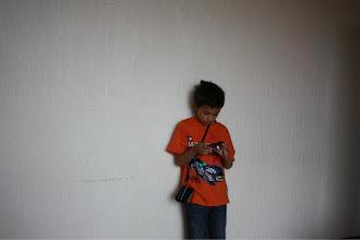 Photo: Danu inspecting camera.