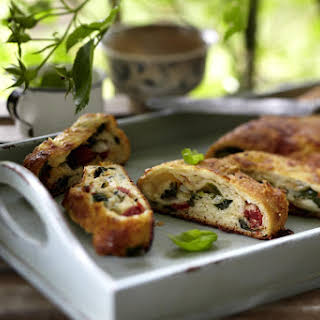 Calzone Pizza Roll with Spinach and Sun-Dried Tomatoes.
