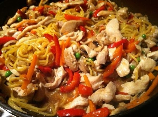 POUR CANTON NOODLES INTO WOK N  MIX WITH CHICKEN N VEGGIES.....ENJOY :)