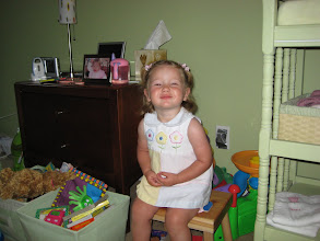 Photo: sitting on the chair Aunt Paula gave her
