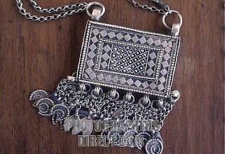 Photo: OMAN : traditional Bedouin jewellery made from Maria Theresa silver dollars
