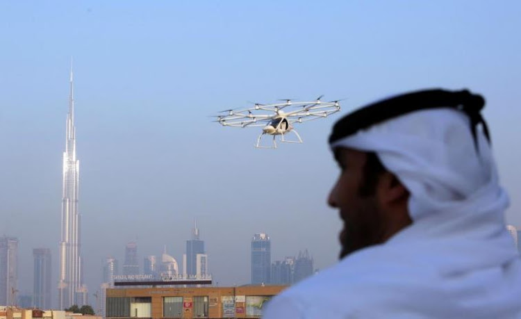 A man looks on as the flying taxi is seen in Dubai, United Arab Emirates . Picture: REUTERS