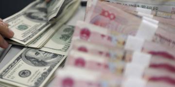 Đòn tiền tệ của Trung Quốc: Việt Nam làm sao chống đỡ ?
