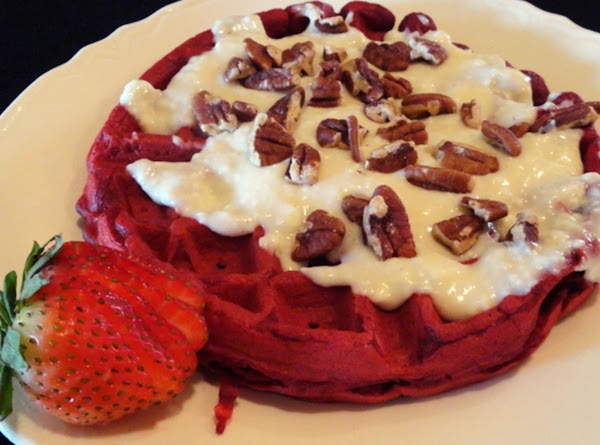 Serve Red Velvet Waffles with warm cream cheese glaze and toasted pecans on top...
