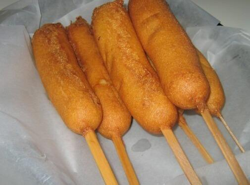 In boiling water put hot dogs, with a skewer in them, to cook until...