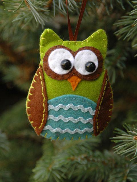An owl ornament hanging on a Christmas tree