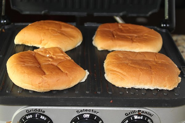 Butter the cut side of each bun and grill until golden about 1-2 minutes,...