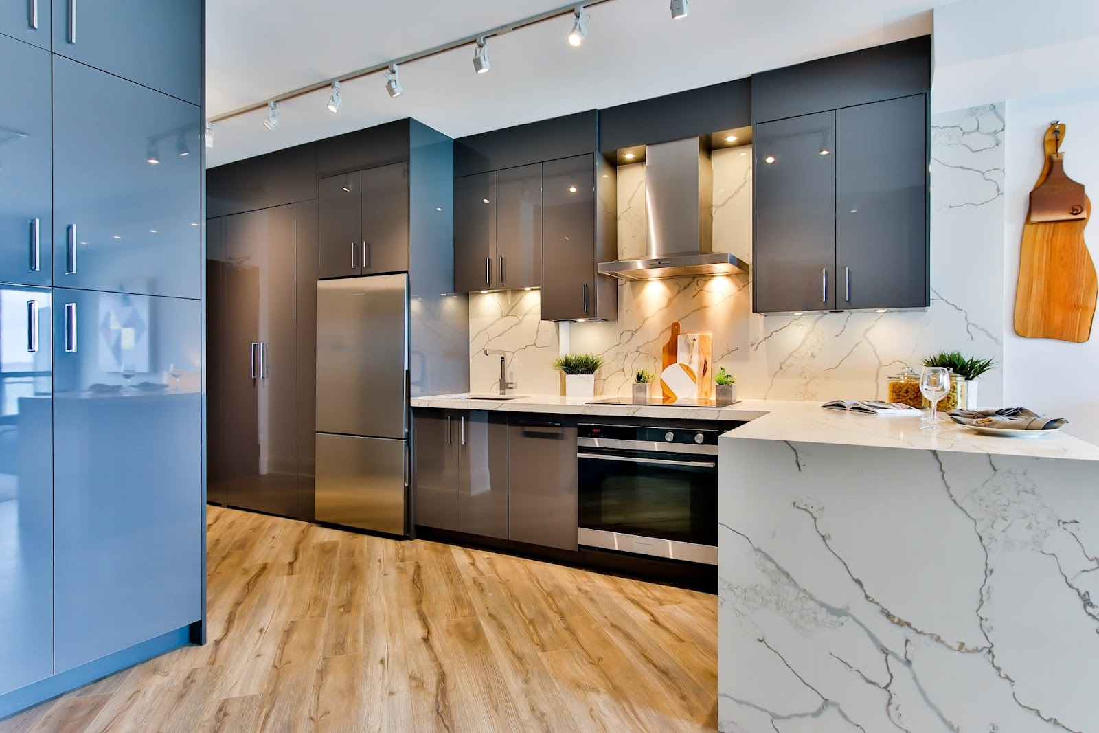 Sleek silver cabinets equipped with stylish handles representing the importance of choosing the perfect kitchen cabinets