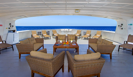 Indulge in comfort on the shaded deck of Treasure of Galapagos from Avalon Waterways.