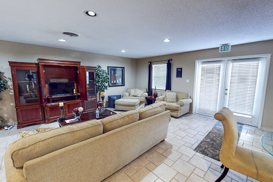 Community clubhouse with lounge seating and TV